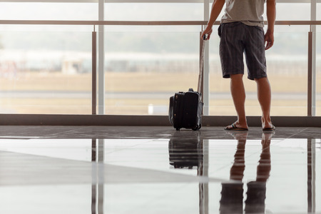 Man carries your luggage at the airport terminal of Bali