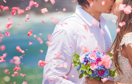 wedding couple just married with bridal bouquet photo