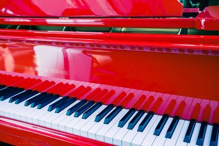 piano key: background of red piano, made in Germany