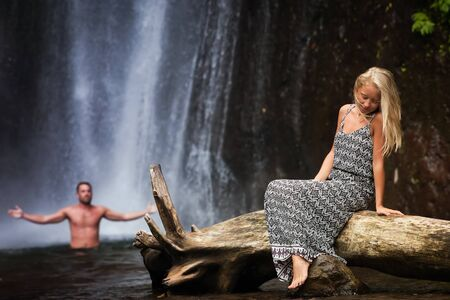 adult indonesia: young woman with  Senior Adult near the waterfall, Indonesia Stock Photo