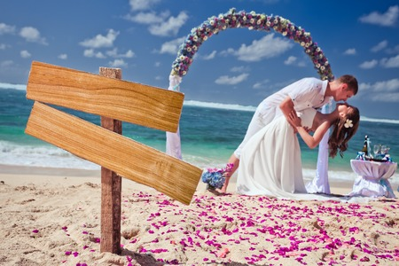 wedding couple just married near the beach at Bali with copy space for text photo