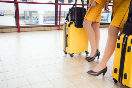 airport terminal: Women carries their luggage at the airport terminal Stock Photo