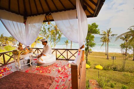 balinese: balinese wedding ceremony with flowers background Stock Photo