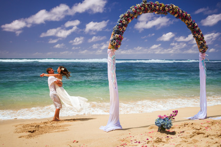 wedding couple just married near the beach at Bali Stock Photo