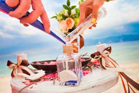 white sand: wedding ceremony - mixing sands is a new family