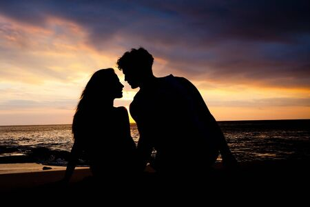first date: First date of a couple at background silhouette