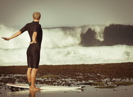 retro revival: Retro revival photo of exercises man or surfer at the beach