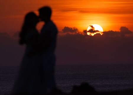 first date: First date of a couple at background silhouette, focus on the sun