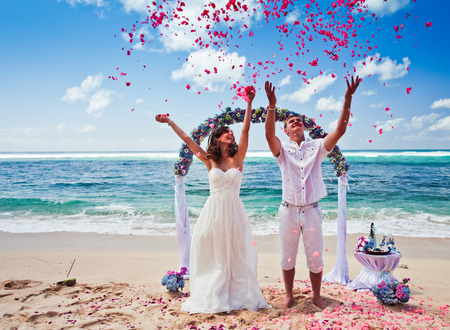 wedding beach: wedding couple just married near the beach at Bali Stock Photo
