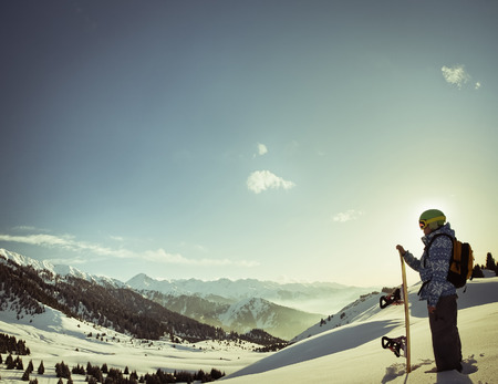 female snowboarder on the background of high snow-capped Alps in Grindelwald, Swiss photo