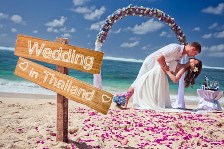 wedding couple just married near the beach at Thailand with copy space for text photo