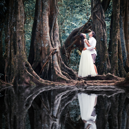 fairy forest: wedding couple in mysterious fairy forest