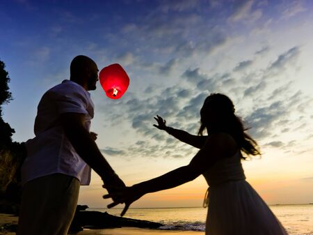 wedding couple at background silhouette with sky lantern