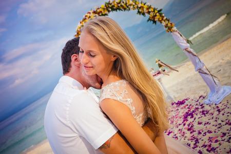 bali beach: wedding couple just married at Bali beach
