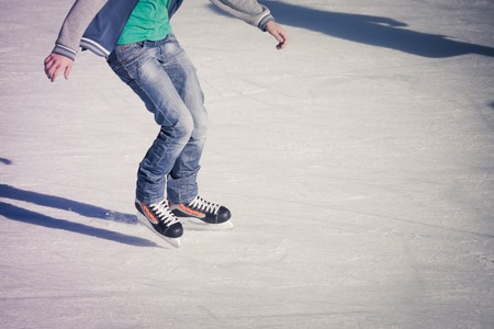 ice background: Image of teenager who are ice skating in the ice rink at the Medeo