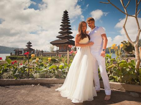 ulun: wedding couple near the famous temple at beratan lake, Bali