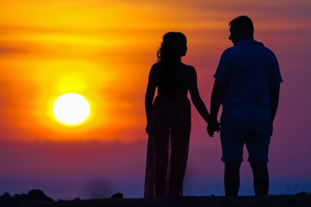 wedding night: silhouette background of first date of a couple Stock Photo