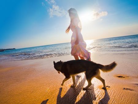 woman traveling with dog near the beach Zdjęcie Seryjne