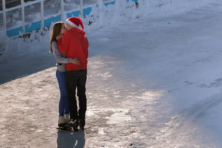 kissing teen couple at ice rink at Medeo, Almaty Stock Photo