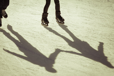 retro revival: shadow background of friendship people on the ice holding hands, retro revival