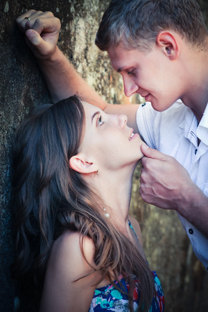 first date: First date of loving couple at background of wall Stock Photo