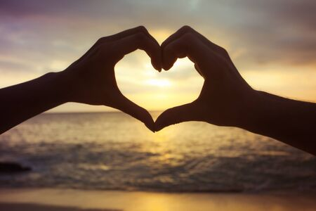 heart - love concept by human hands Stock Photo