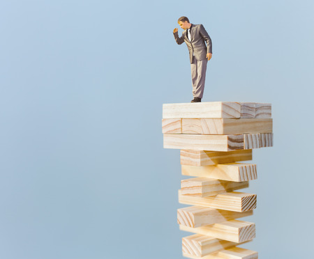 risk manager standing on the top and looking down, with copy space for any text photo