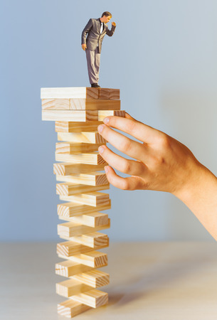 risk manager standing on the top and looking down Stock Photo