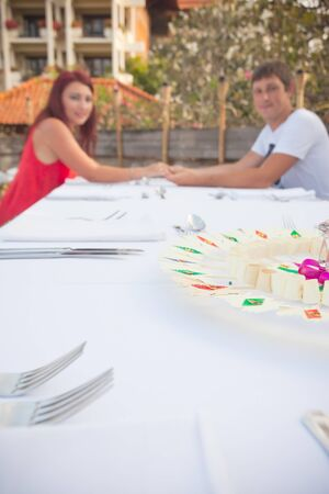 hotel indonesia: young couple in a restaurant near hotel, resort in Bali, Indonesia