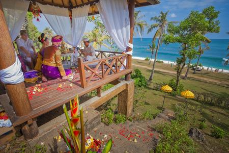 balinese: balinese wedding ceremony with sitting in the gazebo newlyweds Stock Photo