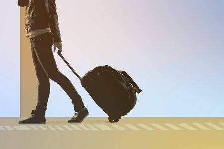 rolling bag: Woman carries your luggage at the airport terminal, and plane flying at the background