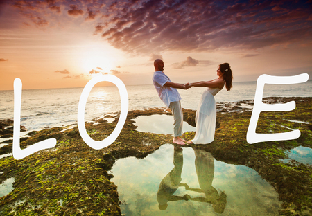 love abstract: wedding couple just married at Hawaii near the beach with love text Stock Photo