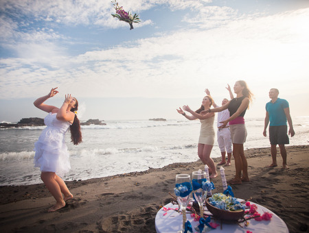throw: Bride throwing bouquet for bridesmaids and groomsmen