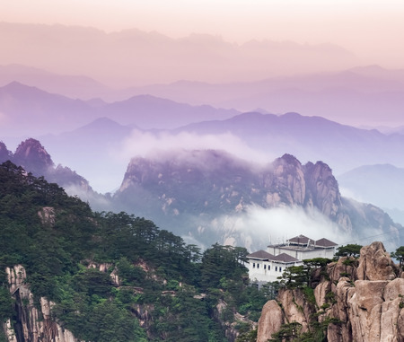 china landscape: Tele image of Huangshan mountain and Chinese hotel at the top. Aerial view at Yellow Mountain. China, Asia