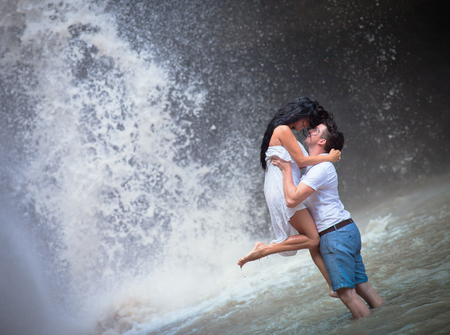 photo of couple travels to Indonesian waterfall photo