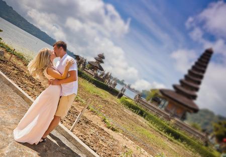 honeymooners: wedding couple near the famous temple at beratan lake, Bali