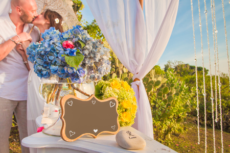 honeymooners: Wedding frame for any text with kissing honeymooners at background
