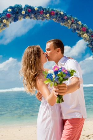 wedding couple just married near the beach at Bali photo