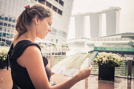 business: tourist adventure with map in singapore