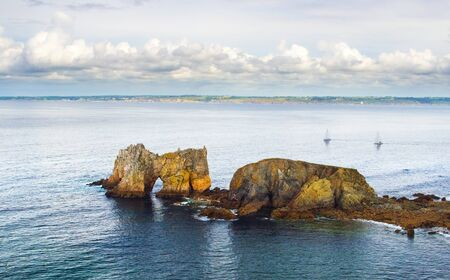 bretagne: The beautiful seascape with rocky castle and island in the water. Finister in Bretagne, France.