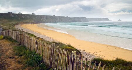 bretagne: Image of beautiful sandy beach with hotels on the rocky island in Bretagne, Finistere, France. Stock Photo