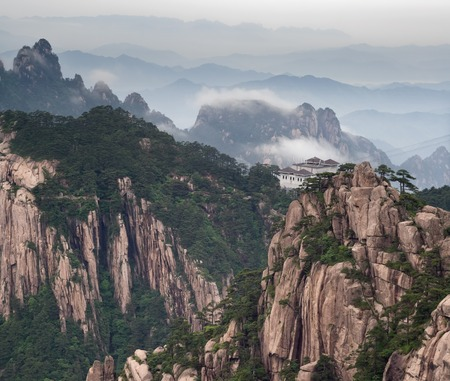tele: Tele image of Huangshan mountain and Chinese style house at cloudy weather, sunset. Aerial view at Yellow Mountain. China, Asia