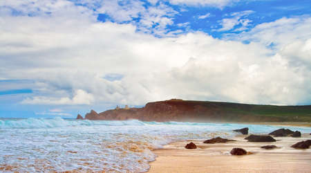 bretagne: Image of beautiful sandy beach with hotels on the rocky island in Bretagne Finistere France. Stock Photo