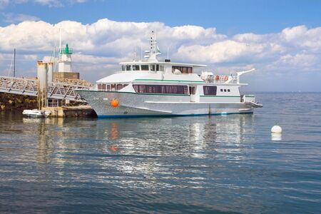 belle: The image of the ferry with the main lighthouse of Sauzon, Belle Ile en Mer. France.