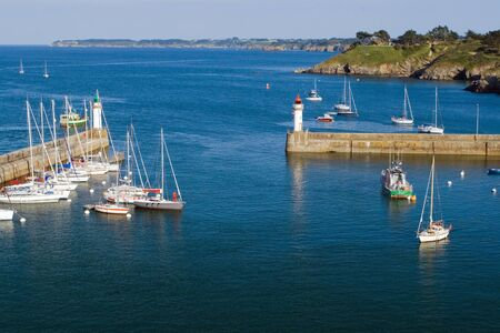 belle: The image of the marina with the yachts and lighthouses of La Palais, Belle Ile en Mer. France.