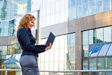 wireless technology: Young businesswomen working on laptop. It's her internet business, through wireless technology
