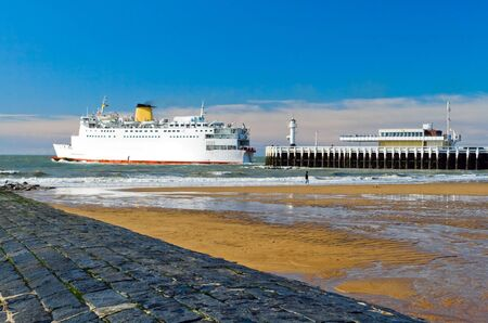 a big ship: The image of the pier, where a big ship sailing from Ostend.