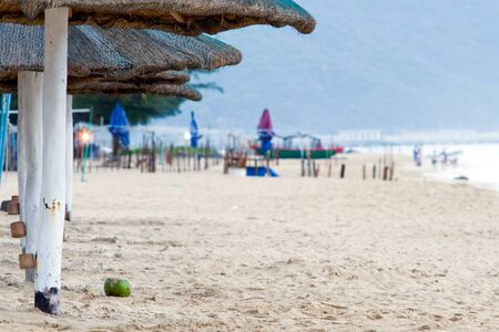 medium group: Image of Hainan beach early in the morning near medium group of beach umbrellas. Stock Photo