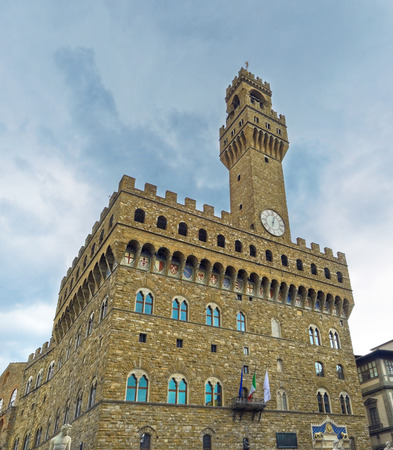The image of the clock tower of the old Palace as a separate fortress in the Roman style, Florence, Italy.