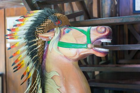 indian headdress: Picture of the interior in the form of a horses head with an Indian headdress of feathers.
